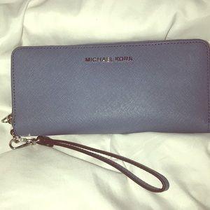 Michael Kors wallet wristlet in blue.